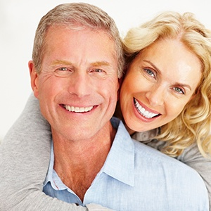 Happy older couple with healthy smiles