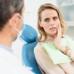 Woman with a toothache at the dentist's