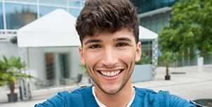 Young man with straight healthy teeth