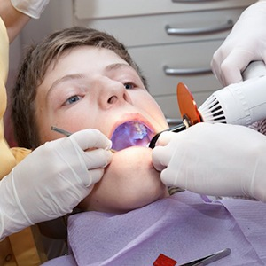 A young patient receiving tooth-colored fillings